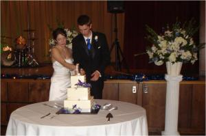 The cake topper has the bride standing on a suitcase.