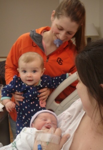 7 mos old Kaedence Grace meets 2 hour old cousin Robert Edward.