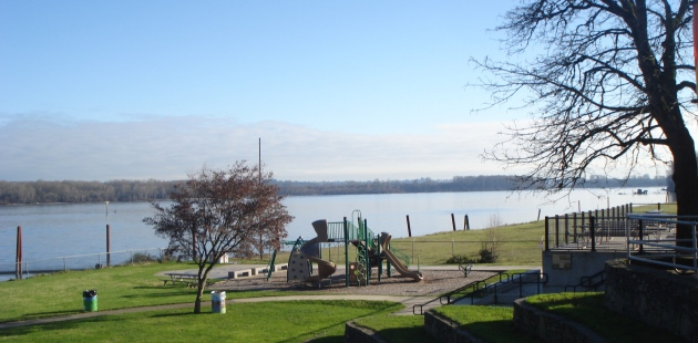 Looking north-east from the park in town. That's probably Washington and some of Sauvie Island.